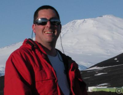John Cassano with Mt. Erebus in the background.